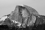 """Half Dome Sunset 3"" Black and White. Yosemite National Park, California. I have posted a series of three photographs of this sunset along with an artistic version where I smoothed out the texture of the rock. This photograph was taken a few minutes before the ""Sunset 2"" image. Capturing Half Dome at sunset really showcases the spectacular colors of its monolithic face.  45,000 people a year climb the famous cables to the summit. I took this picture on my way back down from hiking Yosemite Falls Waterfall."