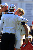 European Team Player Nicolas Colsaerts (BEL) gets a hug from his mother after conceding the match to USA's Dustin Johnson on the 16th green during Sunday's Singles Matches of the 39th Ryder Cup at Medinah Country Club, Chicago, Illinois 30th September 2012 (Photo Colum Watts/www.golffile.ie)