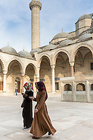 Muslim women in veil and modesty clothing in courtyard of Suleymaniye Mosque, Istanbul, Republic of Turkey