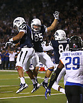 Nevada's Jarred Gipson (47), Matt Moen (85) and Jerico Richardson (84) celebrate following Gipson's touchdown against Boise State during the first half of an NCAA college football game in Reno, Nev., on Saturday, Oct. 4, 2014. Boise State's Dylan Sumner-Gardner (29) is at right. Boise State won 51-46. (AP Photo/Cathleen Allison)