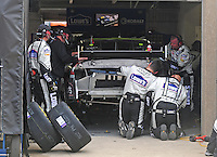 Nov. 8, 2009; Fort Worth, TX, USA; Crew members work to repair the car of NASCAR Sprint Cup Series driver Jimmie Johnson after he crashed on the second lap during the Dickies 500 at the Texas Motor Speedway. Mandatory Credit: Mark J. Rebilas-