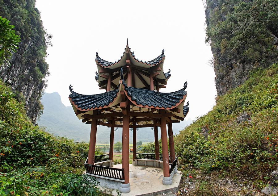 Pagoda between cliffs, Yulang River valley, Yangshuo, Guanxi, China