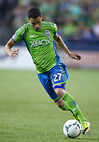 Lamar Neagle of the Seattle Sounders FC dribbles the ball during play against Real Salt Lake at CenturyLink Field in Seattle Friday September 13, 2013. The Sounders won the match 2-0.