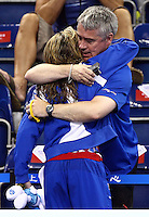 PICTURE BY VAUGHN RIDLEY/SWPIX.COM...Swimming - 14th FINA World Championships 2011 - Oriental Sports Centre, Shanghai, China - 31/07/11...Great Britain's Hannah Miley wins Silver in the Women's 400m Individual Medley Final.  She hugs her dad and coach Patrick Miley after the medal ceremony.