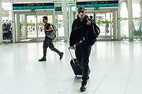 LISBON, PORTUGAL - March 11:  A Passenger wearing a protective mask  its seen in the airport on March 11, 2020 in Lisbon, Portugal. <br /> The International Air Transport Association (IATA) warned earlier on Thursday that the virus could rob passenger airlines of up to $113 billion in revenue this year as fears of a pandemic that could plunge the global economy into recession grow.<br /> Airlines across the globe are rushing to cut flights and costs, and warning of a hit to earnings.<br /> Portugal, whose economy depends heavily on tourism, has so far reported 59 positive cases of the Coronavirus, far fewer than the more than 2200 cases in neighboring Spain.<br /> <br /> (Photo by Luis Boza/VIEWpress vía Getty Images)
