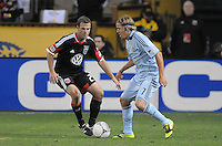 Sporting Kansas City defender Chance Myres (7) goes against D.C. United defender Daniel Woolard (21) Sporting Kansas City defeated D.C. United  1-0 at RFK Stadium, Saturday March 10, 2012.