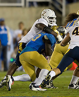 Kendrick Payne of California tackles Johnathan Franklin of UCLA during the game at Rose Bowl in Pasadena, California on October 29th, 2011.  UCLA defeated California, 31-14.