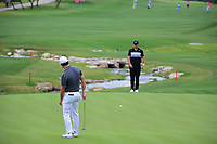 Cody Gribble (USA) barely misses his putt on 18 as Brooks Koepka (USA) watches on during round 1 of the Valero Texas Open, AT&amp;T Oaks Course, TPC San Antonio, San Antonio, Texas, USA. 4/20/2017.<br /> Picture: Golffile | Ken Murray<br /> <br /> <br /> All photo usage must carry mandatory copyright credit (&copy; Golffile | Ken Murray)