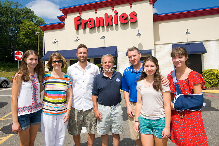 WATERBURY, CT-0712117JS01--, The Poulos family of Beacon Falls, from left, Rachel Poulos; Lauren Poulos; Paul Martelli and Joe Joe Caiazzo of Frankie's; Stacy Poulos; Chloe Poulos and Kimberly Poulos. They were the winners of the Frankie's Catered Event contest. Jim Shannon Republican-American