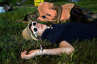 BENICÀSSIM, SPAIN - English tourists lie passed out on the grass in the festival site. ..Described by some as a Mediterranean Glastonbury, the Festival Internacional de Benicàssim (FIB) is the largest music festival outside the UK to target British visitors. In 2010, seven of the eight main headline slots were filled by English bands...A small coastal town of 13,000 inhabitants, Benicàssim hosted some 200,000 visitors in 2009, with 40% of those believed to be coming from the UK. In 2010, attendances fell to 127,000 visitors but the percentage of UK visitors is believed to have risen.
