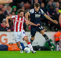 11th January 2020; Bet365 Stadium, Stoke, Staffordshire, England; English Championship Football, Stoke City versus Milwall FC; Joe Allen of Stoke City under pressure from Jayson Molumby of Millwall - Strictly Editorial Use Only. No use with unauthorized audio, video, data, fixture lists, club/league logos or 'live' services. Online in-match use limited to 120 images, no video emulation. No use in betting, games or single club/league/player publications