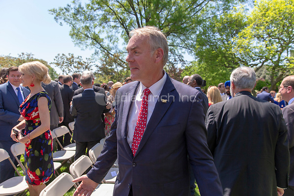 Secretary of the Interior Ryan Zinke speaks with guests after a National Day of Prayer event in the Rose Garden at the White House in Washington, DC on May 3, 2018. Credit: Alex Edelman / CNP /MediaPunch