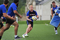 Tom Homer of Bath Rugby passes the ball. Bath Rugby training session on August 4, 2015 at Farleigh House in Bath, England. Photo by: Patrick Khachfe / Onside Images
