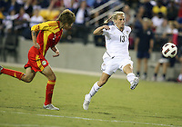 Kristine Lilly #13 of the USA WNT shoots past Yuan Xu #8 of the PRC WNT during an international friendly match at KSU Soccer Stadium, on October 2 2010 in Kennesaw, Georgia. USA won 2-1.