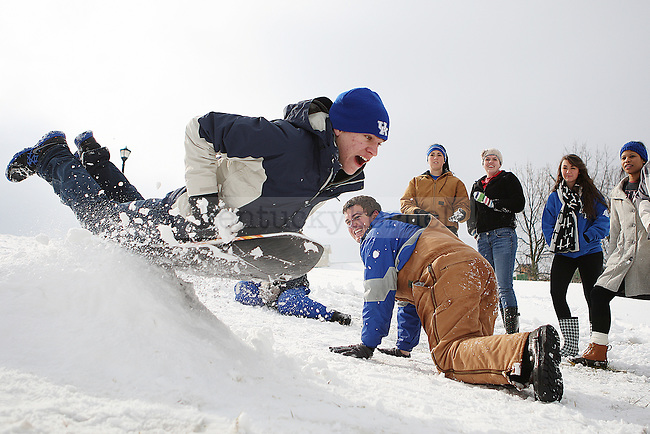 "Evan Atwell flies over a ramp while sledding in ""the Bowl"" outside the William T. Young Library in Lexington, Ky.,on Monday, February 3, 2014. Photo by Michael Reaves 