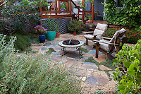 Outdoor firepit on permeable flagstone patio with California native plants, Heath-Delaney garden