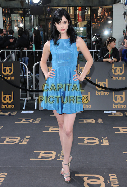"KRYSTEN RITTER.The Universal Pictures' L.A. Premiere of ""Bruno"" held at the Grauman's Chinese Theatre in Hollywood, California, USA. .June 25th, 2009.full length blue dress sleeveless hands on hips .CAP/DVS.©Debbie VanStory/Capital Pictures."