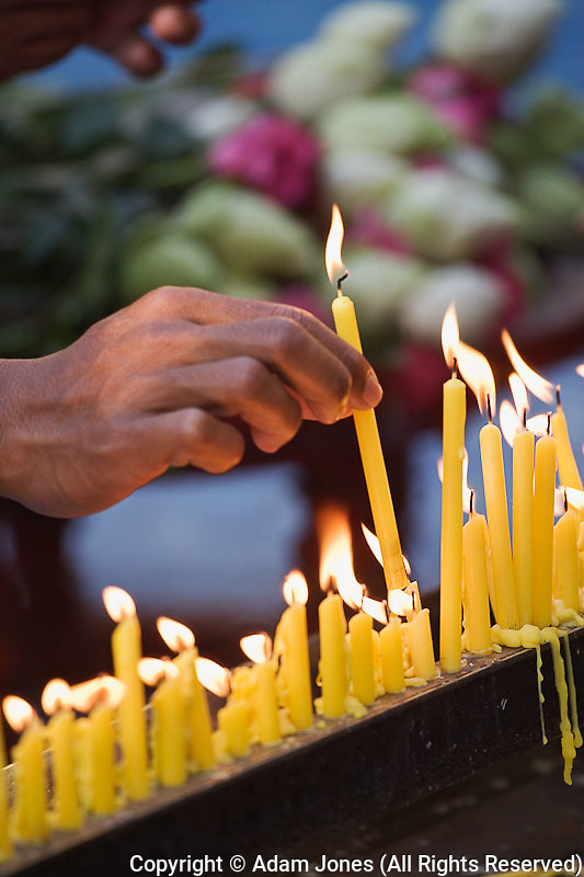 Lighting of candle symbolizes wisdom  and drives away darkness, Wa Phra That Doi Suthep Rajvoravihara, Chiang Mai, Thailand