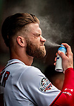 1 August 2018: Washington Nationals outfielder Bryce Harper applies sunscreen prior to facing the New York Mets at Nationals Park in Washington, DC. The Nationals defeated the Mets 5-3 to sweep the 2-game weekday series. Mandatory Credit: Ed Wolfstein Photo *** RAW (NEF) Image File Available ***