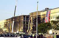 11 September 2017 - America remembers the fateful day of 9/11/2001 on the commemoration on the 16th anniversary of the terrorist attacks that killed nearly 3,000 people when hijackers flew commercial airplanes into New York's World Trade Center, the Pentagon and a field near Shanksville, Pennsylvania File Photo: Sep 12, 2001; Washington, DC, USA; The Pentagon crash site after about 126 people died after an attack on America by terrorists. <br /> CAP/ADM/LF<br /> &copy;LF/ADM/Capital Pictures