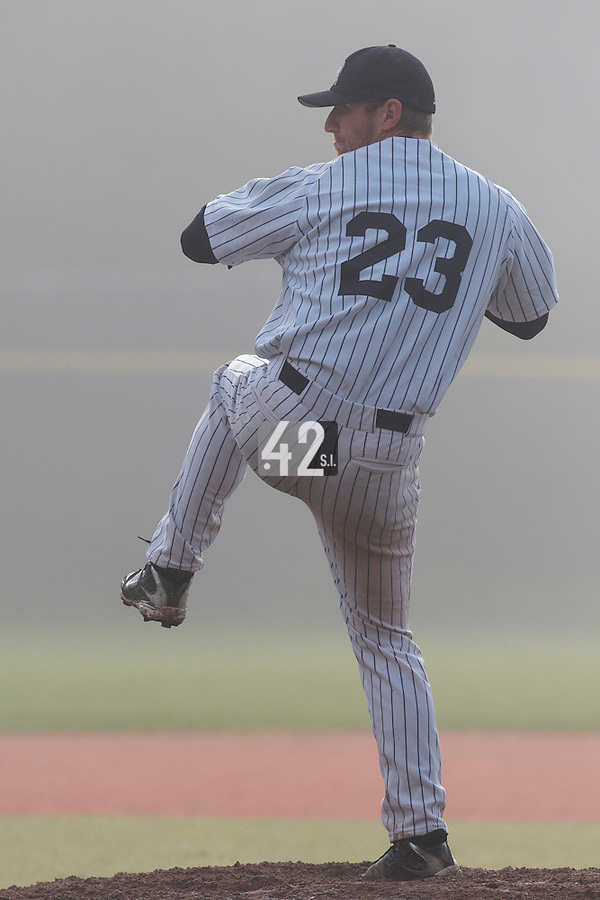 24 October 2010: Aaron Hornostaj of Rouen pitches against Savigny in the fog during Savigny 8-7 win (in 12 innings) over Rouen, during game 3 of the French championship finals, in Rouen, France.