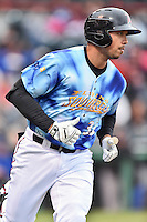 Richmond Flying Squirrels first baseman Ricky Oropesa (33) runs to first during a game against the Hartford Yard Goats at The Diamond on April 30, 2016 in Richmond, Virginia. The Yard Goats defeated the Flying Squirrels 5-1. (Tony Farlow/Four Seam Images)