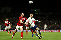14th January 2020; Tottenham Hotspur Stadium, London, England; English FA Cup Football, Tottenham Hotspur versus Middlesbrough; Son Heung-Min of Tottenham Hotspur competes for the ball with Paddy McNair of Middlesbrough - Strictly Editorial Use Only. No use with unauthorized audio, video, data, fixture lists, club/league logos or 'live' services. Online in-match use limited to 120 images, no video emulation. No use in betting, games or single club/league/player publications