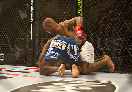 24.06.2011, Washinton, USA.   Eduardo Pamplona attempts to get a hold on Jerron Peoples during the STRIKEFORCE Challengers at the ShoWare Center in Kent, Washington. Pamplona knocked Peoples out in the first round.