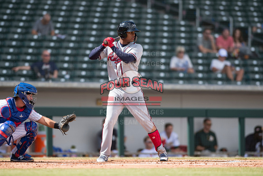 Peoria Javelinas center fielder Cristian Pache (27), of the Atlanta Braves organization, at bat in front of catcher P.J. Higgins (12) during an Arizona Fall League game against the Mesa Solar Sox at Sloan Park on October 11, 2018 in Mesa, Arizona. Mesa defeated Peoria 10-9. (Zachary Lucy/Four Seam Images)