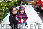 Brandly MacCormac-Hill and mom Kristy Hill enjoying the snow covered front lawn in Manor on Friday last.