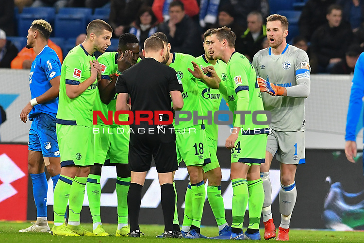 01.12.2018, wirsol Rhein-Neckar-Arena, Sinsheim, GER, 1 FBL, TSG 1899 Hoffenheim vs FC Schalke 04, <br /> <br /> DFL REGULATIONS PROHIBIT ANY USE OF PHOTOGRAPHS AS IMAGE SEQUENCES AND/OR QUASI-VIDEO.<br /> <br /> im Bild: Matija Nastasic (#5, FC Schalke 04), Salif Sane (FC Schalke 04 #26), Daniel Caligiuri (FC Schalke 04 #18), Suat Serdar (FC Schalke 04 #8) und Bastian Oczipka (FC Schalke 04 #24) diskutieren mit Schiedsrichter Dr. Robert Kampka nach der Gelben Karte fuer Matija Nastasic (#5, FC Schalke 04)<br /> <br /> Foto © nordphoto / Fabisch