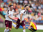 Tony Watt celebrates hitting the winner for Hearts in the last minute with team mate Harry Souttar as Ziggy Gordon sits dejected in the background