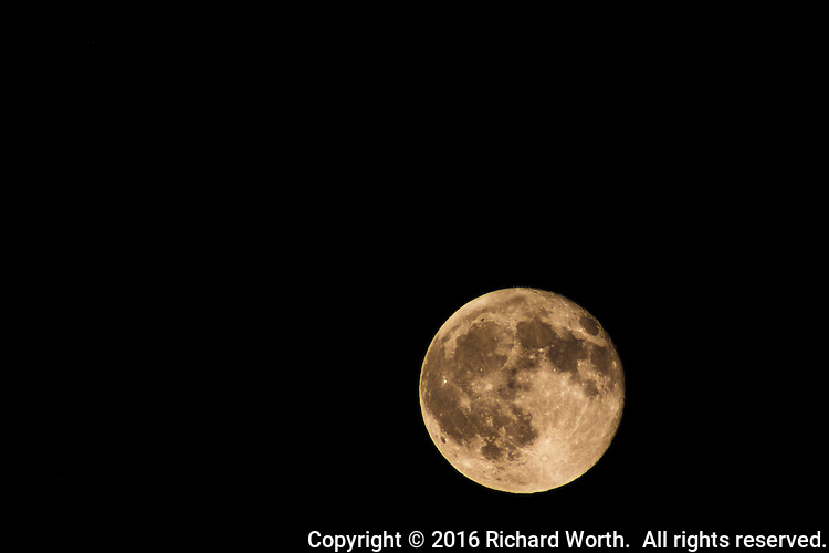 Tonight's full moon is tinged by smoke from the Lower Lake or Clayton wildfire north of the San Francisco Bay Area.