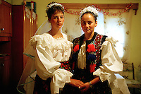 ROMANIA / Maramures / Budesti / 02.09.2006..Ileana, a 16 year-old bride, left, with her friend Maria at home on her wedding day...© Davin Ellicson / Anzenberger