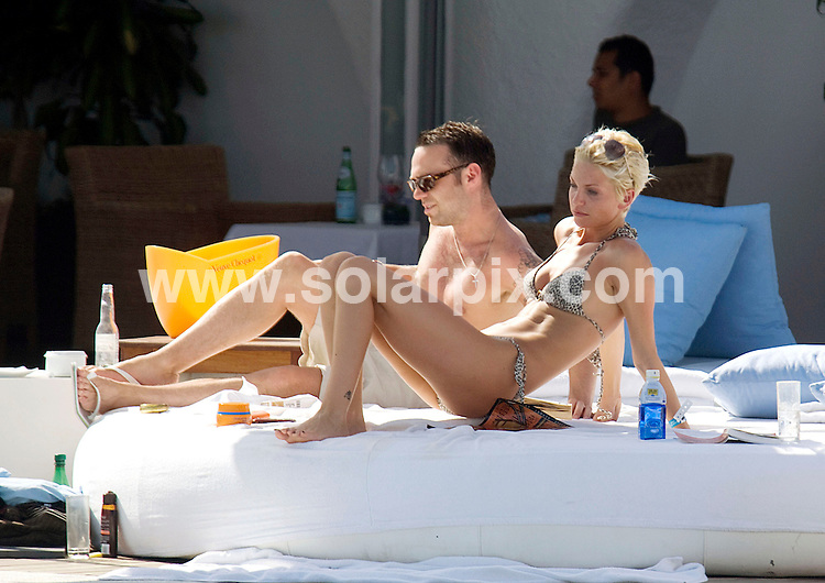 "**ALL ROUND EXCLUSIVE  PICTURES FROM SOLARPIX.COM**.                  **WORLDWIDE SYNDICATION RIGHTS**.""Girls Aloud"" Sarah Harding takes a short sunshine break in the med between UK tour dates with her on off Fiance DJ Tom Crane.An onlooker said.She spent the afternoon lounging and drinking by the pool at The ""Ocean Club Marbella"" with her boyfriend until either the sun or the booze.got to her ! She looked very wobbly as she shuffled to the edge of the pool a held her head then dropped in the water.She needed a helping hand from her Bo to steady herself to get dressed "".JOB REF:  7071        JS/SF       DATE:21.08.08.**MUST CREDIT SOLARPIX.COM OR DOUBLE FEE WILL BE CHARGED* *UNDER NO CIRCUMSTANCES IS THIS IMAGE TO BE REPRODUCED FOR ANY ONLINE EDITION WITHOUT PRIOR PERMISSION*"