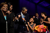 Washington, DC - October 13, 2009 -- United States President Barack Obama and First Lady Michelle Obama, along with daughters Sasha and Malia, and Marian Robinson, dance during the In Performance at the White House: Fiesta Latina concert on the South Lawn of the White House, October 13, 2009. .Mandatory Credit: Pete Souza - White House via CNP