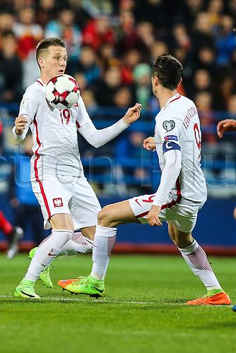March 26th 2017, Podgorica City Stadium,  Montenegro; World Cup 2018 Internationl football qualification, Montenegro versus Poland;  Piotr Zielinski (POL) and Robert Lewandowski (POL)