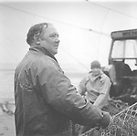 Salmon netter Mike Smith standing next to one of his 'jumper' nets at St. Cyrus, Aberdeenshire.<br /> Ref. Catching the Tide 08/01/11 (26th June 2001)<br /> <br /> The once-thriving Scottish salmon netting industry fell into decline in the 1970s and 1980s when the numbers of fish caught reduced due to environmental and economic reasons. In 2016, a three-year ban was imposed by the Scottish Government on the advice of scientists to try to boost dwindling stocks which anglers and conservationists blamed on netsmen.
