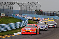Aug. 8, 2009; Watkins Glen, NY, USA; NASCAR Nationwide Series driver Marcos Ambrose leads a pack of cars during the Zippo 200 at Watkins Glen International. Mandatory Credit: Mark J. Rebilas-