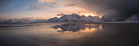 Mountain reflection on Ytresand beach at sunrise, Moskenesøy, Lofoten Islands, Norway