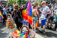 New York, NY- Gay Pride Parade in the West VIllage - Vendor selling Rainbow Flags, Leis and other pride paraphenalia at Stonewall Place near Christopher Street