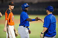 AZL Cubs shortstop Delvin Zinn (21) fist bumps third base coach Ben Carhart during a game against the AZL Giants on September 5, 2017 at Scottsdale Stadium in Scottsdale, Arizona. AZL Cubs defeated the AZL Giants 10-4 to take a 1-0 lead in the Arizona League Championship Series. (Zachary Lucy/Four Seam Images)