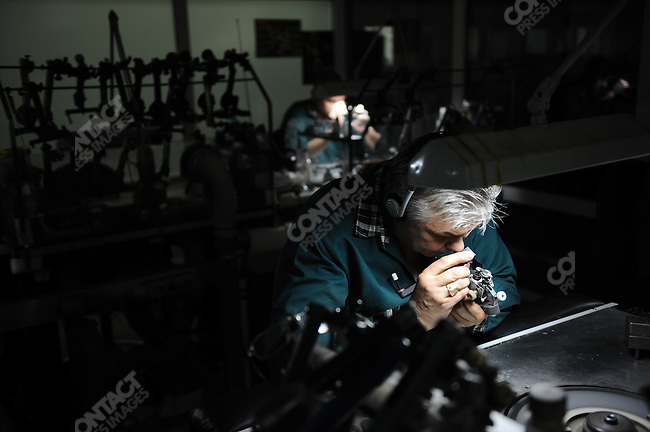 At the Alrosa cutting and polishing centre in Moscow, a worker examined a diamond he was polishing. Moscow, Russia, May 8, 2009.