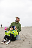 USA, Washington State, Long Beach Peninsula, International Kite Festival, father and son fly a kite