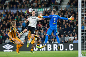8th September 2017, Pride Park Stadium, Derby, England; EFL Championship football, Derby County versus Hull City; David Nugent of Derby County jumps up to head the ball but misses as Hull City goalkeeper Allan McGregor jumps and prepares to catch the ball