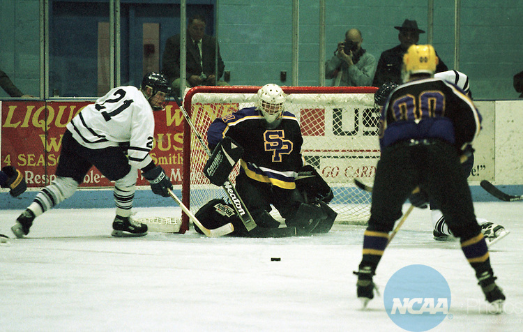 Caption: 21 MAR 1998: Forward Curt Goldman (21) of Middlebury College makes a play in front of the net during the NCAA Divison 3 Men's Hockey Championship held at the Stafford Ice Arena in Plattsburgh, NY. Middlebury College defeated University of Wisconsin-Stevens Point 2-1 to win the championship for the fourth straight year an NCAA record. David Herskowitz/NCAA Photos