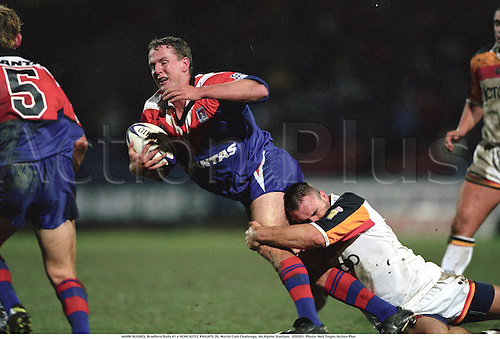 MARK HUGHES, Bradford Bulls 41 v NEWCASTLE KNIGHTS 26, World Club Challenge, McAlpine Stadium,  020201. Photo: Neil Tingle/Action Plus...2002.rugby league.superleague.club clubs.tackle tackles tackling