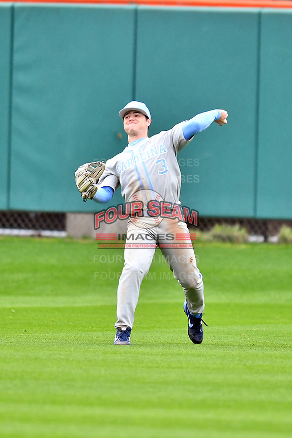 North Carolina Tar Heels center fielder Dylan Harris (3) throws the ball during a game against the Clemson Tigers at Doug Kingsmore Stadium on March 9, 2019 in Clemson, South Carolina. The Tigers defeated the Tar Heels 3-2 in game one of a double header. (Tony Farlow/Four Seam Images)