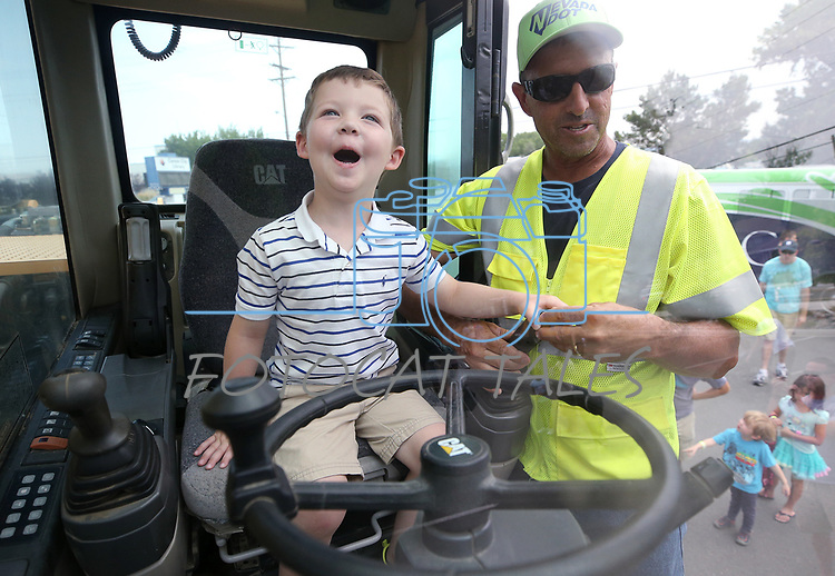 Walker Odom, 3, learns about Nevada Department of Transportation heavy equipment during the Touch-a-Truck event at the Carson City Library in Carson City, Nev., on Saturday, Aug. 5, 2017. More than 600 people participated in this year&rsquo;s Summer Learning Challenge, themed &ldquo;Build a Better Community&rdquo;.<br /> Photo by Cathleen Allison/Nevada Photo Source