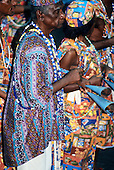 Bahia, Brazil. Carnival; musicians in traditional Afro Brazilian Muzenza style playing double bells.